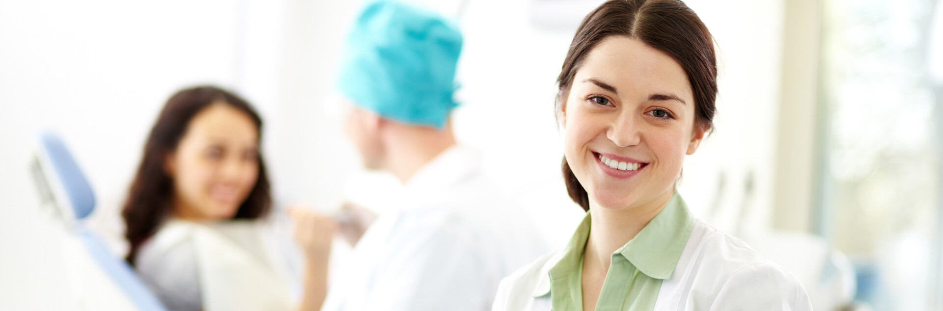 Dental assistant smiling looking a the camera